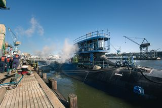 This image has an empty alt attribute; its file name is USSMTC-Photo-MONTANA-at-Pier-after-Launch-Ashley-Cowan-HII.jpg